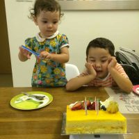 Shot of Kids and a cake - how life is now all about the kids