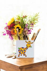 Shot of Giraffe painting and flowers